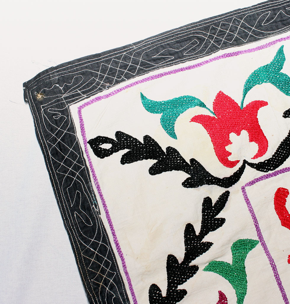 Close up corner detail of vintage soviet era embroidered suzani