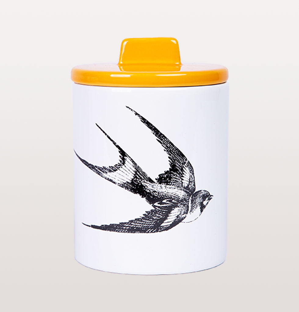 W.A.GREEN | KITSCH KITCHEN | The black and white swallow design is set off against the lovely yellow pink lid. Medium sized storage jar. Perfect lidded jar in the kitchen for tea and coffee, in the bathroom for cotton wool pads or in the bedroom for hair bands, you'll love it.