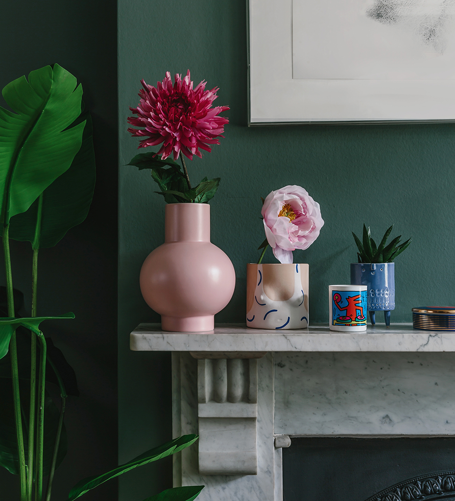 Large pink ceramic flower vase on mantlepiece Raawii. wagreen.co.uk