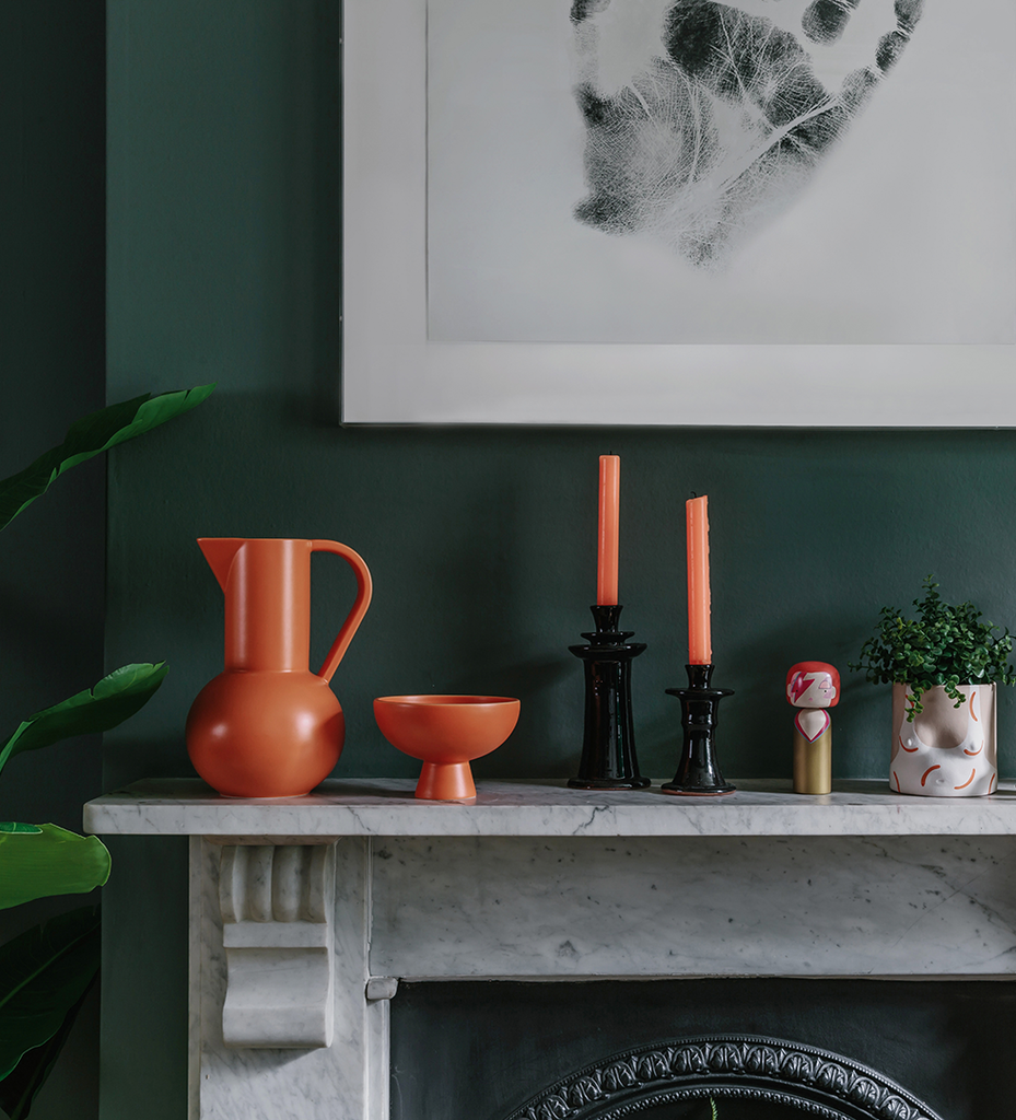 Bright orange collection of ceramics