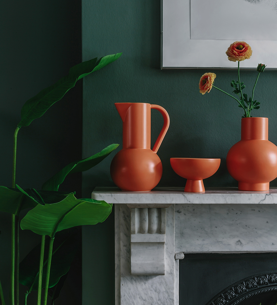 Raawii ceramics in bright orange jug bowl and vase