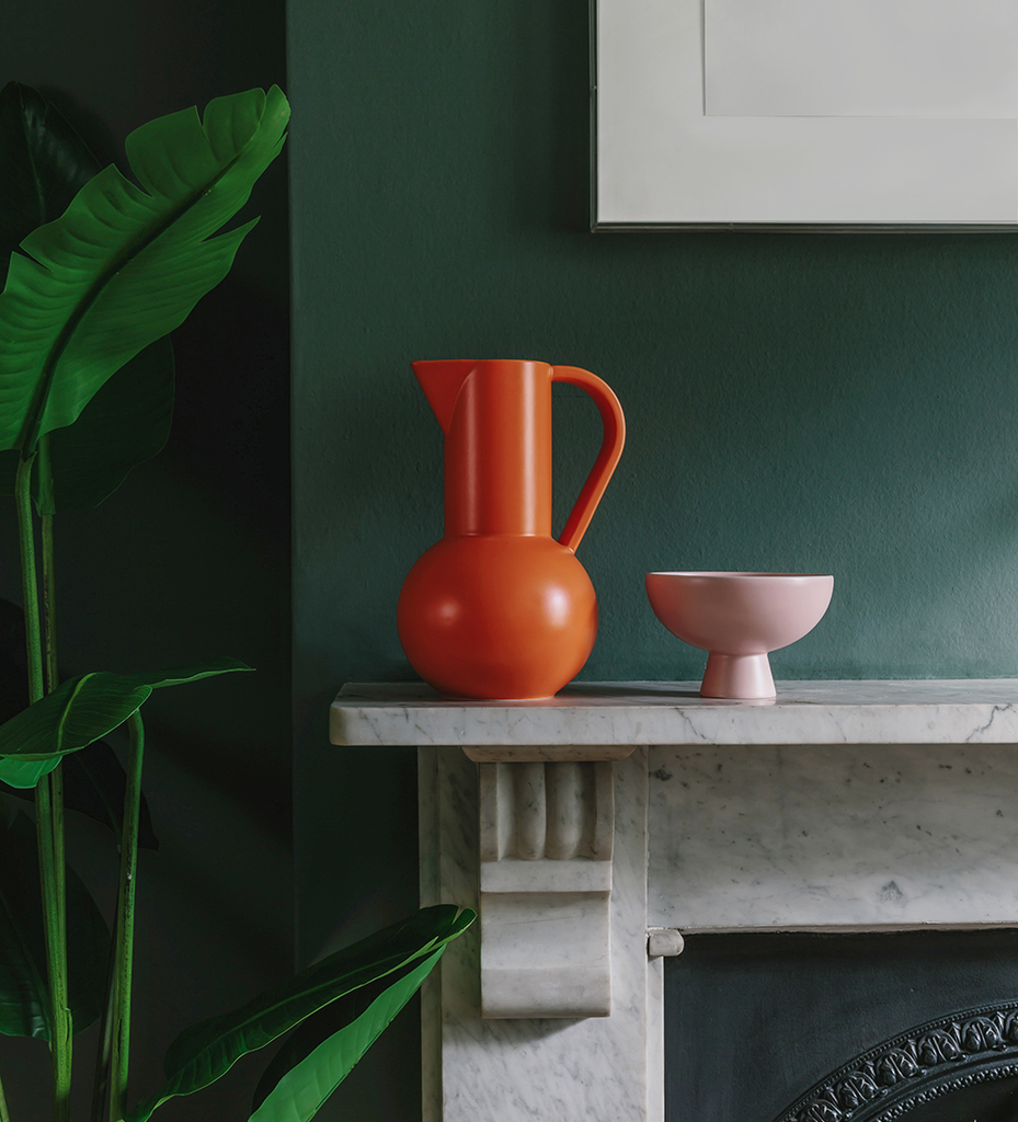 Contemporary ceramics in dark green interior