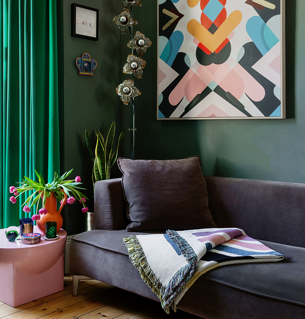 Living room inspiration with bright artwork and colourful ceramics featuring mila table by Pulpo, Slowdown Studio throw and Raawii large orange jug. wagreen.co.uk