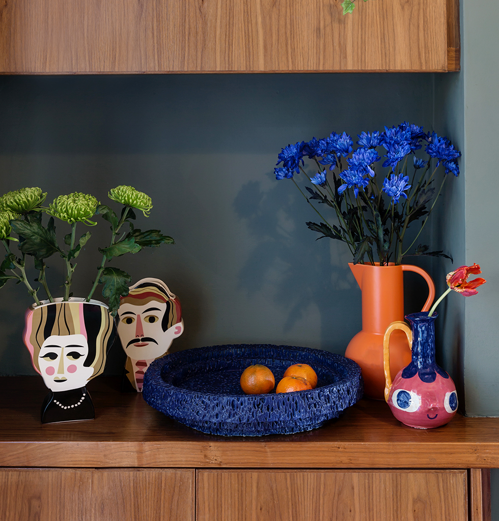 Ultimate shelfie with Mr Peterson and Mrs Hoffman vase, large orange Raawii ceramic jug and Neolit blue bowl by Pulpo