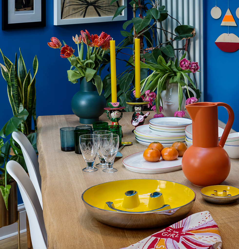 Tablescape featuring tableware from Canvas Home and glassware from Milagros. Beautiful ceramics including candleholders from Kitsch Kitchen and the green vase and orange jug from raawii. wagreen.co.uk