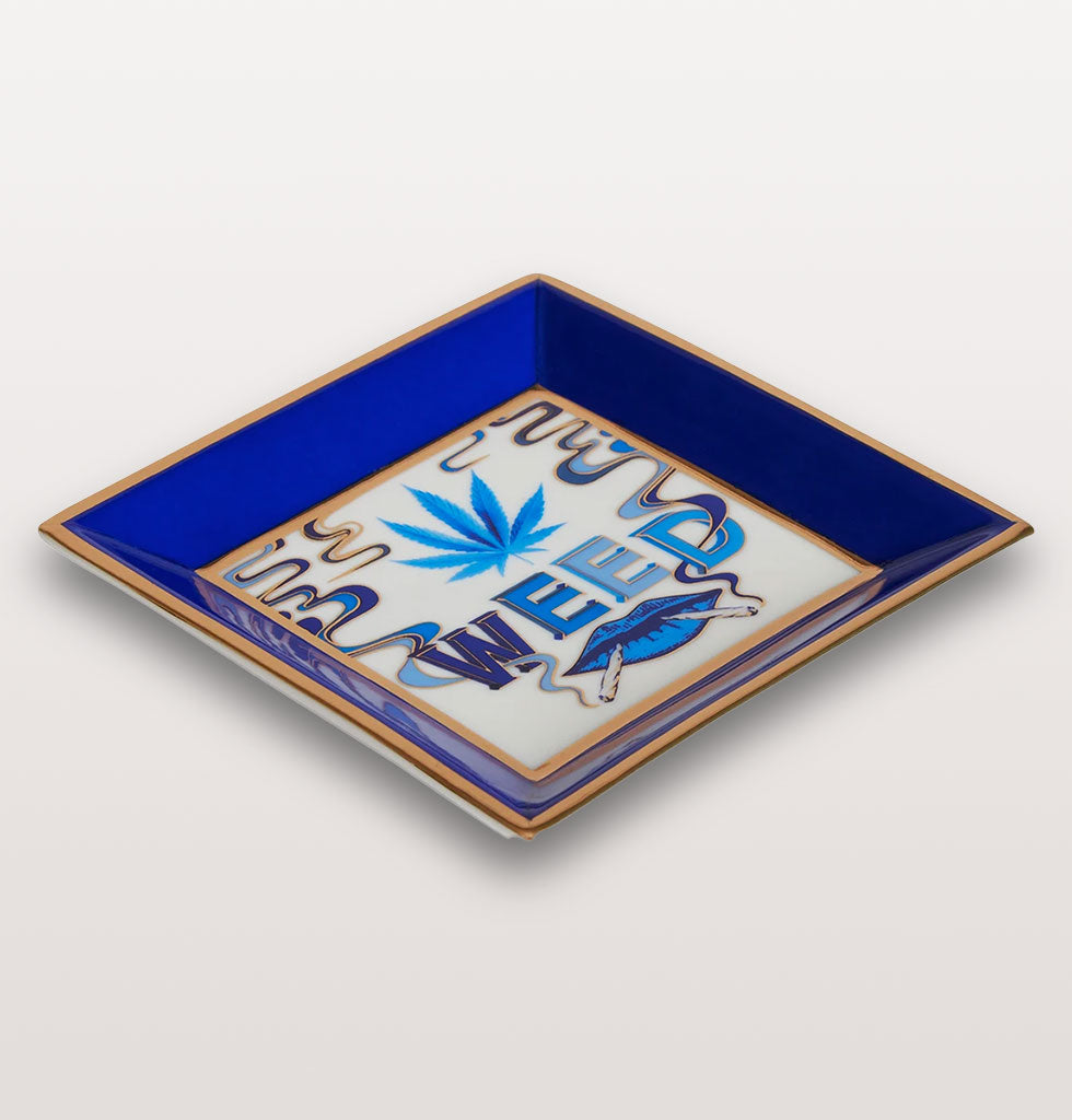Druggist square weed tray. Blue and gold ashtray written with WEED. Jonathan Adler. £48