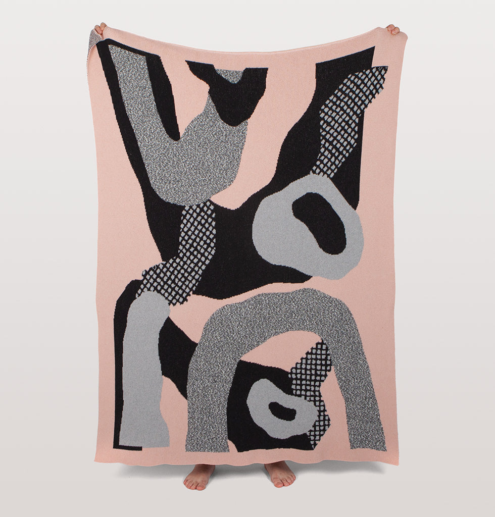 Wilder knit Slowdown Studio blanket. Pink, grey and black design by Marina Timm. Limited Edition sofa blanket.