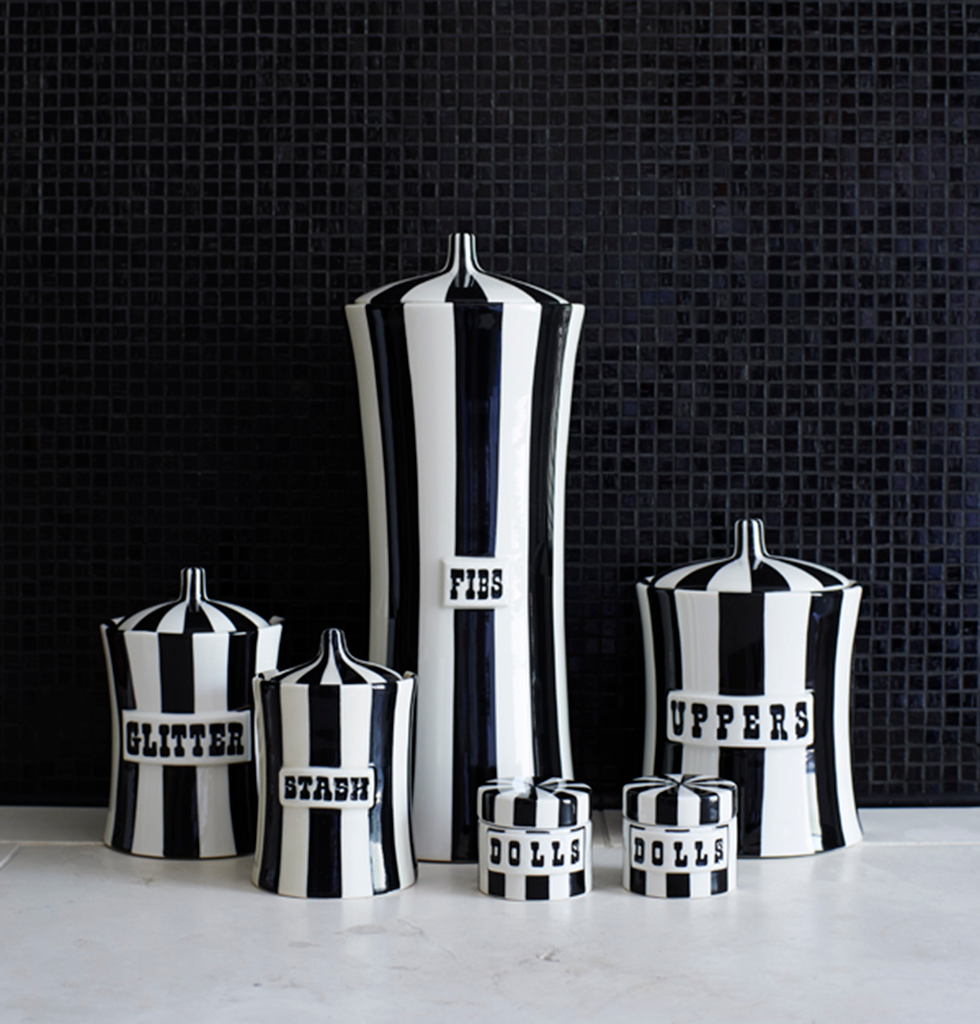 Jonathan adler black and white striped vice jars in bathroom