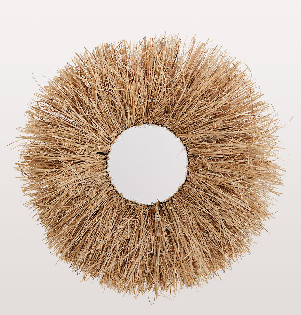 "This show-stopping round grass framed mirror not only frames your reflection it is also a sunburst of texture for your abode.  A lovely lions mane of pale straw coloured grass for instant drama, texture and a sense of adventure to any room.   W.A.Green says: ""Smile, you're a natural beauty""."