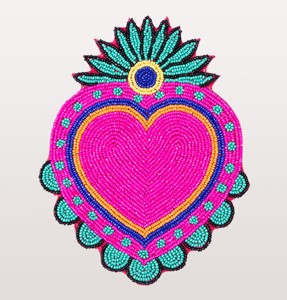 W.A.GREEN | KITSCH KITCHEN | Taking inspiration from Mexico, these brightly coloured oversized coasters are a fabulous way to spread the love at your table whilst entertaining or having a cosy night in. We have always been a fan of neon and these hand beaded heart shaped table mats add a splash of colour to your table and your life.   Heart shaped Mexican milagro pink, green, yellow, blue and black beaded place mat coasters. £25 wagreen.co.uk