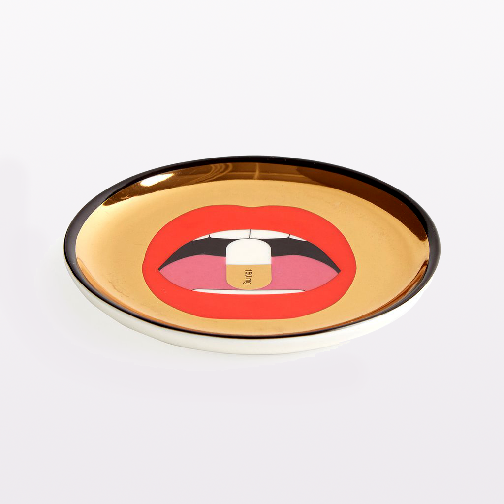 gold coaster with red mouth and pill by jonathan adler full dose coasters