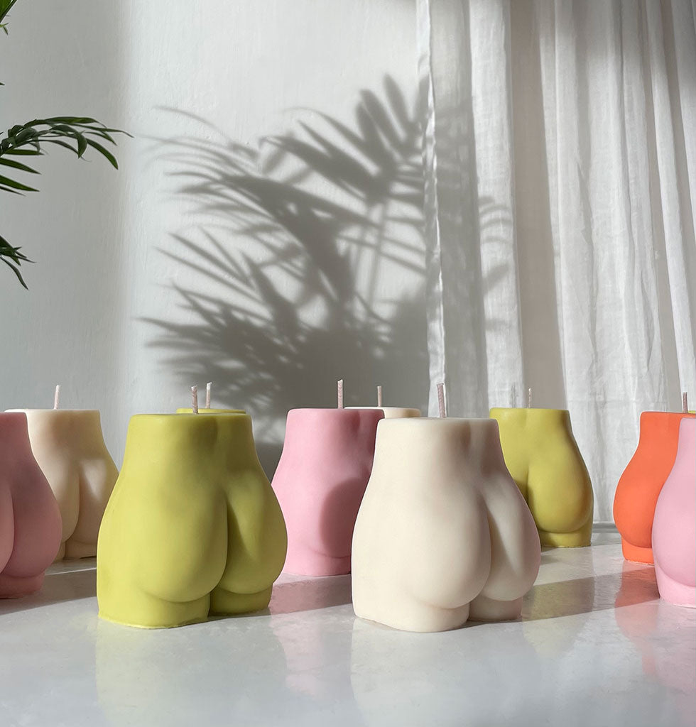 Nude bum bum coloured candles by Pose Wax. £18 wagreen.co.uk