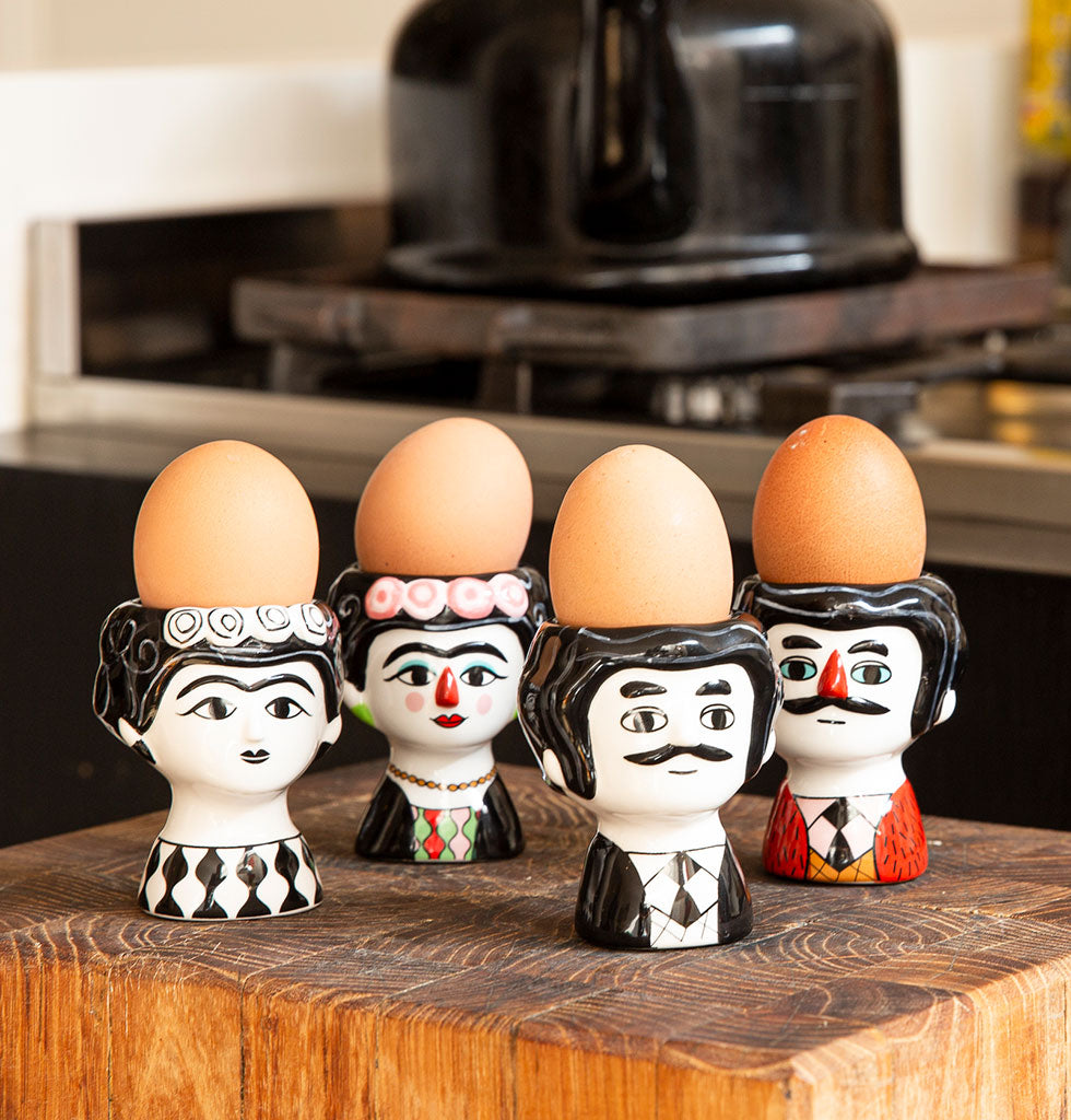 W.A.GREEN | KITSCH KITCHEN | Black and white and multi coloured Carlos and Marisol shaped ceramic egg cup holders from wagreen.co.uk