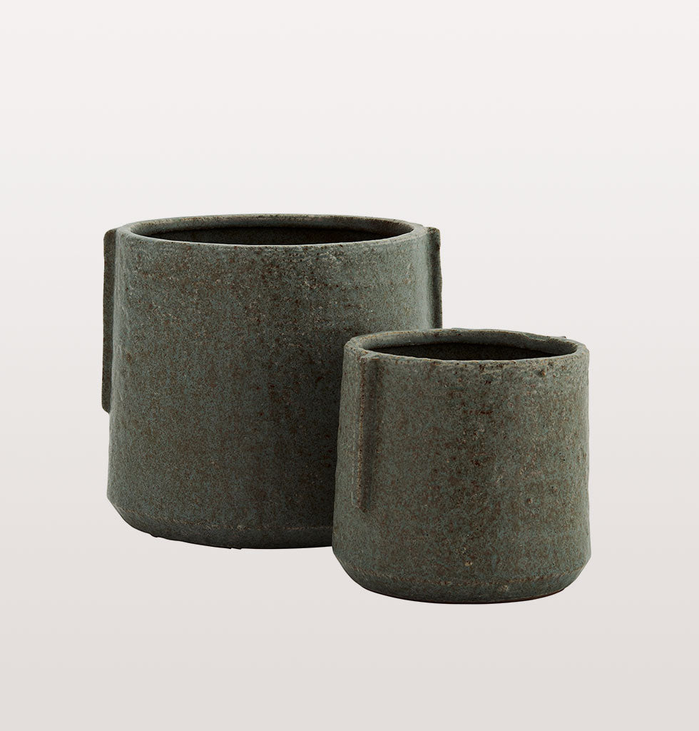 "Set of two smoke green grey terracotta plant pots. Strong and simple design for a minimal look with maximum impact for your indoor pot plants.   The black smoke grey green colour looks stunning against the red of the terracotta clay and adds depth and texture to your interior style.  W.A.Green says: ""Double up your indoor greenery with these Brutalist inspired plant pots"".  Set of 2 plant pots.  Size: 15.5x12.5 