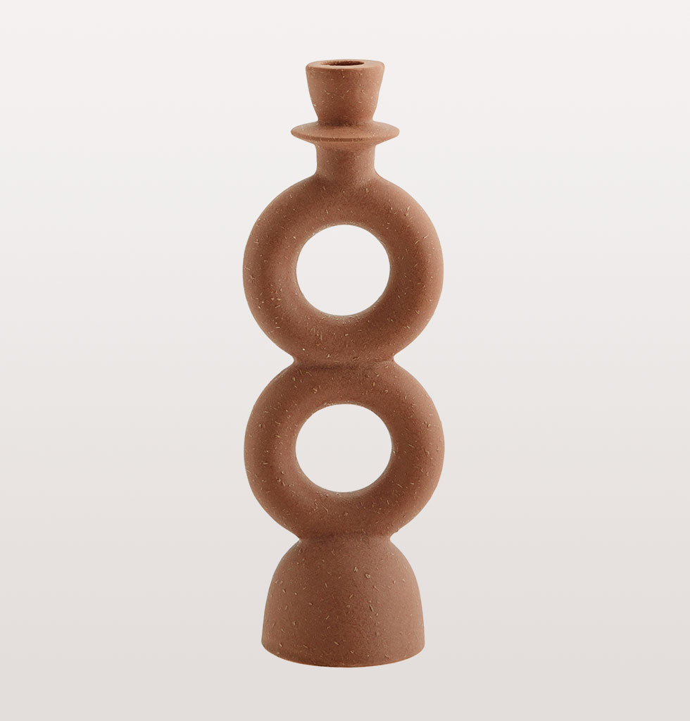 MADAM STOLTZ | TERRACOTTA CIRCLES CANDLEHOLDER | Beautiful natural terracotta circles candleholder.  Everything looks better lit by candle light and this dramatic double circle candleholder is an easy statement for your table or mantlepiece. The natural finish and round design of these smart candle sticks makes us think of drawing circles in the sand.  The smooth red brick coloured terracotta has been shaped by hand and adds a curvaceous sexiness to any tablescape. £24 wagreen.co.uk
