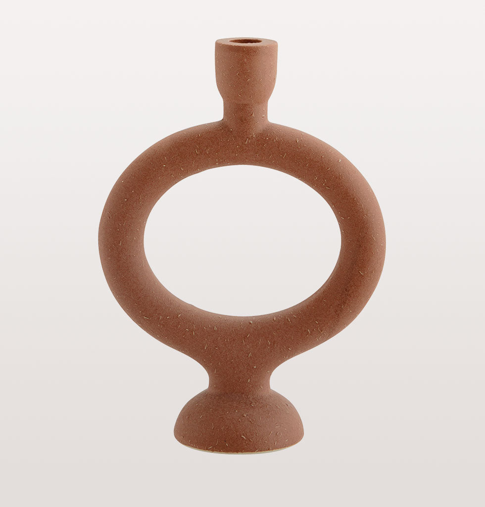 MADAM STOLTZ | OVAL TERRACOTTA CANDLEHOLDER | Elegant and natural oval terracotta candleholder  Everything looks better lit by candle light and this sumptuous oval moulded candleholder is a beautiful addition to your tablescape of dreams. The natural finish and round design of this candle stick is striking yet simple.  The smooth red brick coloured terracotta has been shaped by hand and adds a curvaceous sexiness to any table top or mantlepiece.