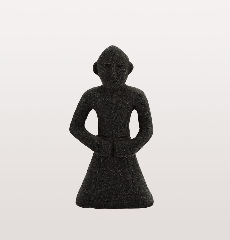 "This simple small black Inca inspired stoneware statue is an easy way to add some drama and show off your spirit of adventure.   Cute Peruvian style stone statue bursting with personality. Ideal decorative statue for shelves and coffee tables.  W.A.Green says: ""This simple statue is the type of thing we like to pick up when we're on our travels""."