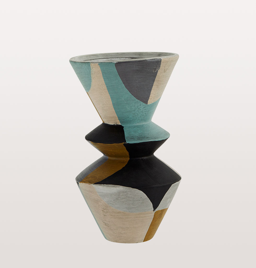 "The striking shapes and colours of this terracotta flower vase are reminiscent of an abstract art piece or modern sculpture.   Made from terracotta and hand painted with an envious colour palette of turquoise blue, soft grey, black, pale pink and mustard yellow.   W.A.Green says: ""Natural grass stems like bunny tails  would look amazing in this abstract terracotta vase"".  Each vase has it's own qualities due to the natural material and hand painted finish."