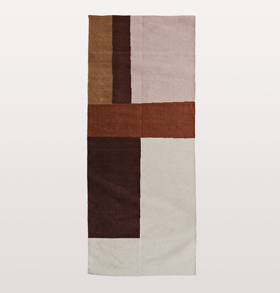 "A beautifully hand woven rusty red cotton runner rug from India in warm earthy cognac browns, khaki, rose and off-white in a flat weave.   We love this combination of neutral colours, natural materials and organic lines.   W.A.Green says: ""Make an entrance with this simply stunning floor runner rug for your hallway""."