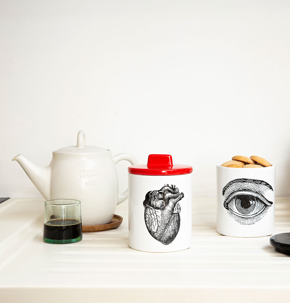 W.A.GREEN | KITSCH KITCHEN | The black and white heart design is set off against the lovely bright red lid and eye storage jar with yellow lid. Medium sized storage jar. Perfect lidded jar in the kitchen for tea and coffee, in the bathroom for cotton wool pads or in the bedroom for hair bands, you'll love it. wagreen.co.uk