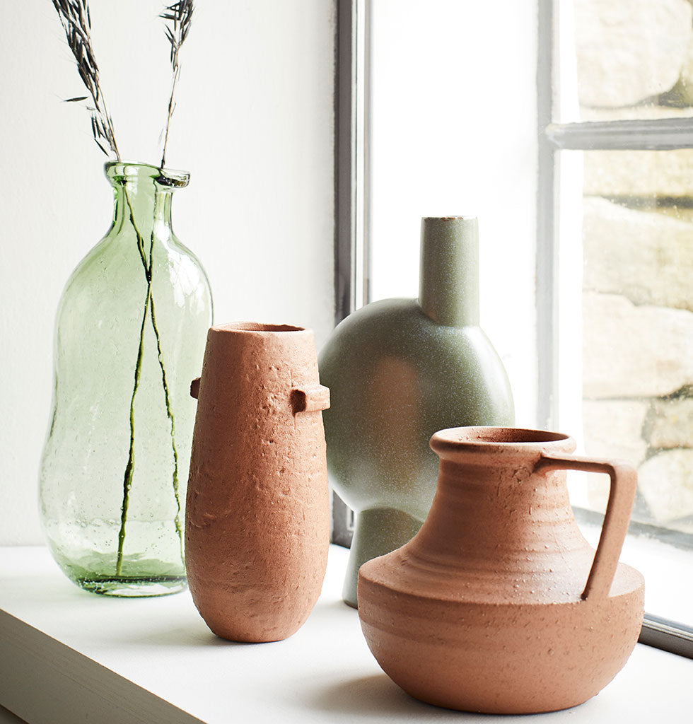 "Inspired by the Brutalist movement this flower vase combines bold modern curves with a soft sage green colour and smooth finish.   Arrange your favourite blooms or style it solo for a nod to contemporary style.  W.A.Green says: "" For minimal maintenance try forever flowers or soft dried grasses."