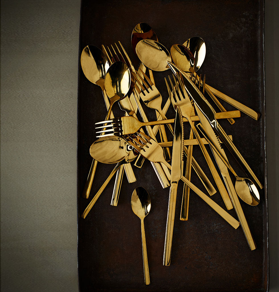 Divine gold stainless steel cutlery set from Madam Stoltz. Four person set of utensils includes fork, knife, spoon and teaspoon. This modern gold cutlery set has a beautiful weight and feel in your hands making every meal memorable.