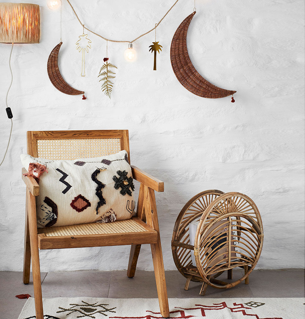 There's nothing like flicking through a magazine for daydreaming and inspiration. This elegant cane magazine rack is perfect for the side of the sofa. It's open circular shape makes dipping into your favourite edition all the more fabulous. Made from natural bamboo cane, this basket is both strong and stylish.