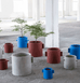 Serax concrete planters in red brown and blue