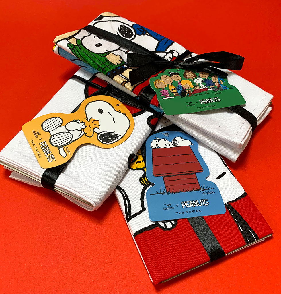 Adorable bundle of 3 Peanuts tea towels. Tied with ribbon, making this a gorgeous gift for any deserving home.   Featuring the whole gang from our favourite cartoon including Charlie Brown and Snoopy.    Set of 3 Snoopy Dish Towels  Happiness in being one of the gang I think I'm allergic to mornings LOVE. £34 wagreen.co.uk