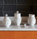 Jonathan Adler Utopia Hip Hop Legend Jars in kitchen with dollar sign lids