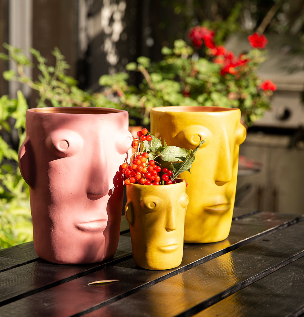 Head honcho Cabeza is in charge of sunshine. His bright pink giant head is the statement vase your tropical flowers have been crying out for.    Bold Mexican inspired vase for a real hot house vibe. Add a pop of pink and go large at home.  Let's face it, this hand painted large pink flower vase has massive smile value.