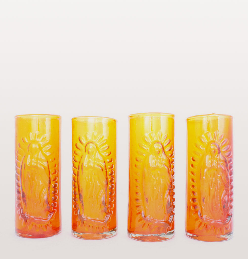 MILAGROS | MEXICAN GLASSWARE | Virgin of Guadalupe embossed Mexican glassware. Our Lady of Guadalupe is iconic throughout Mexico and these recycled hand made bright orange coloured highball tumblers are beautiful reminders of this beautiful country. £34 wagreen.co.uk