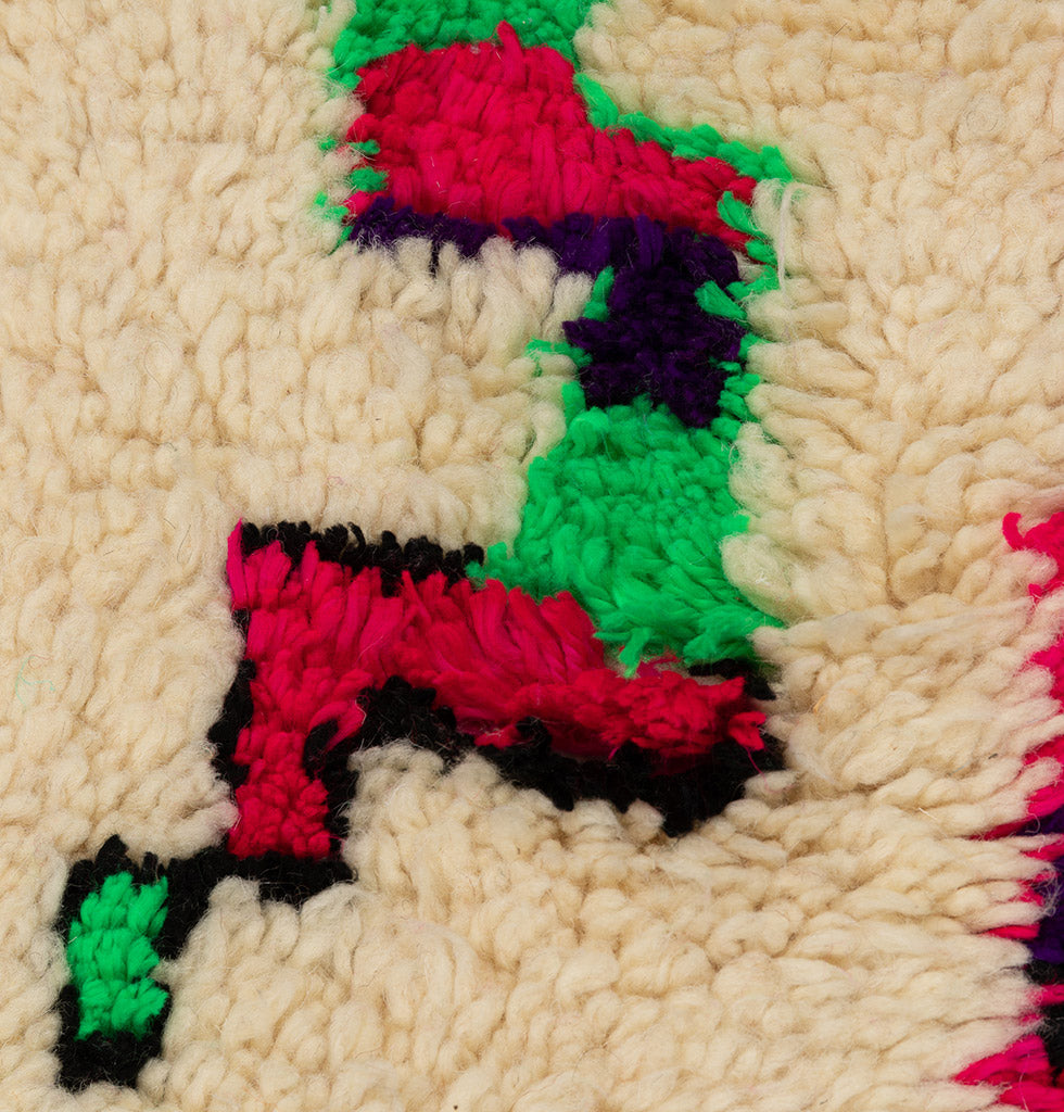 Azilal Berber rug in cream with neon green, red and black design. £760 wagreen.co.uk
