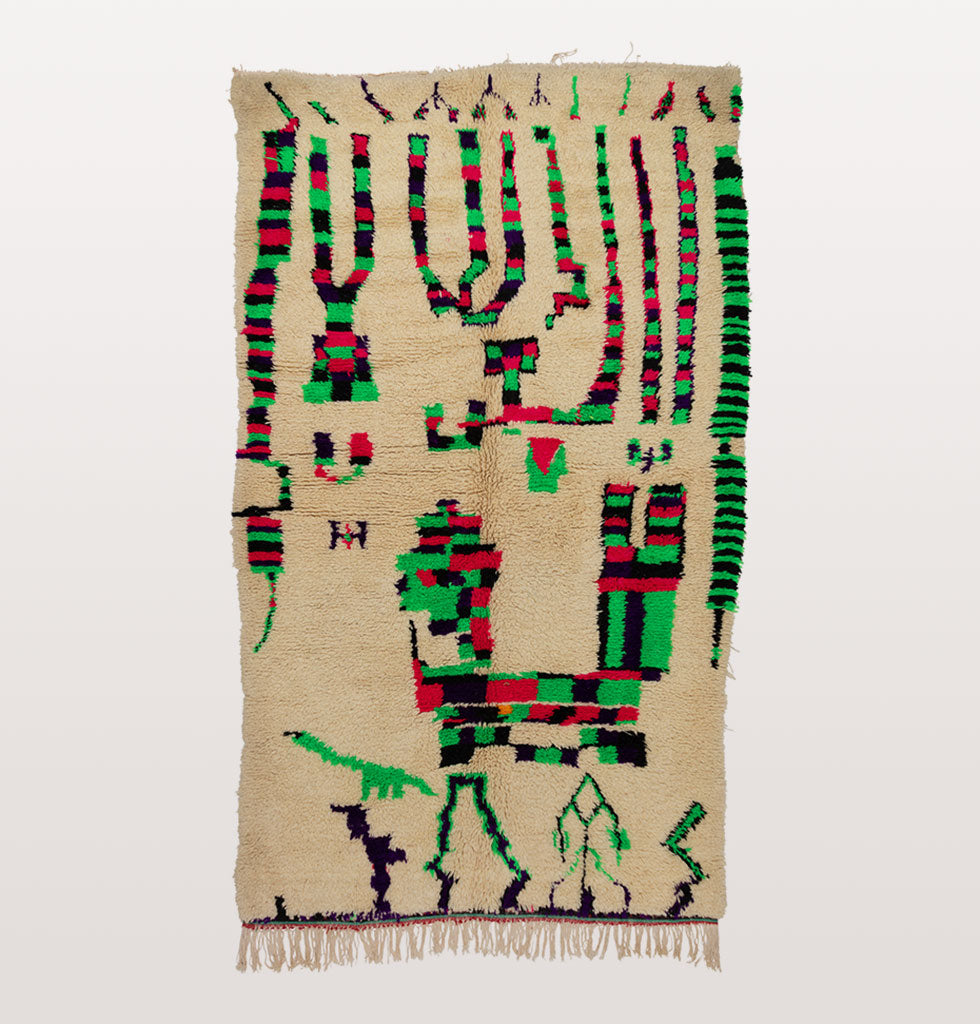 Azilal Berber rug in cream with neon green, red and black design.
