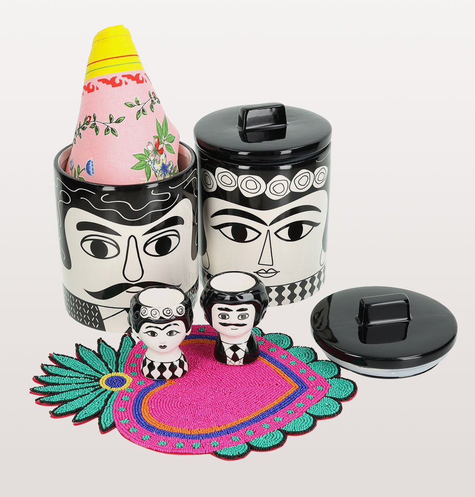 W.A.GREEN | HOME SWEET HOME GIFT SET | Kitsch Kitchen Marisol and Carlos storage jars and black and white Carlos and Marisol egg cup set. Pink beaded milagro heart coaster and Tijuana tea towel. £99 wagreen.co.uk