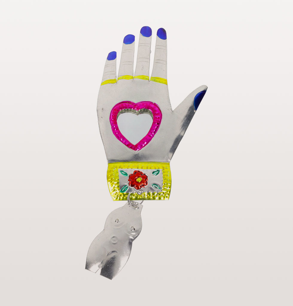 Pink heart and blue nails Mexican miracle hand mirror. £21 wagreen.co.uk