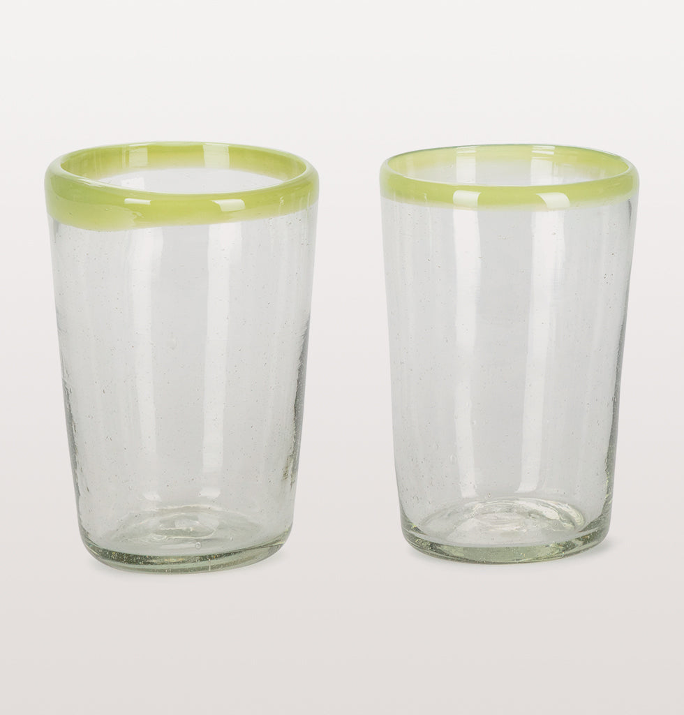 Loving the lime green zing to these beautiful recycled Mexican glass tumblers. Heavy and handblown, each glass is unique and full of character. The bright green coloured rim is gloriously uneven making every sip special.   These strong glass tumblers are as delicious for water or beer. Made in Mexico by hand, preserving traditional glass making techniques for future generations.