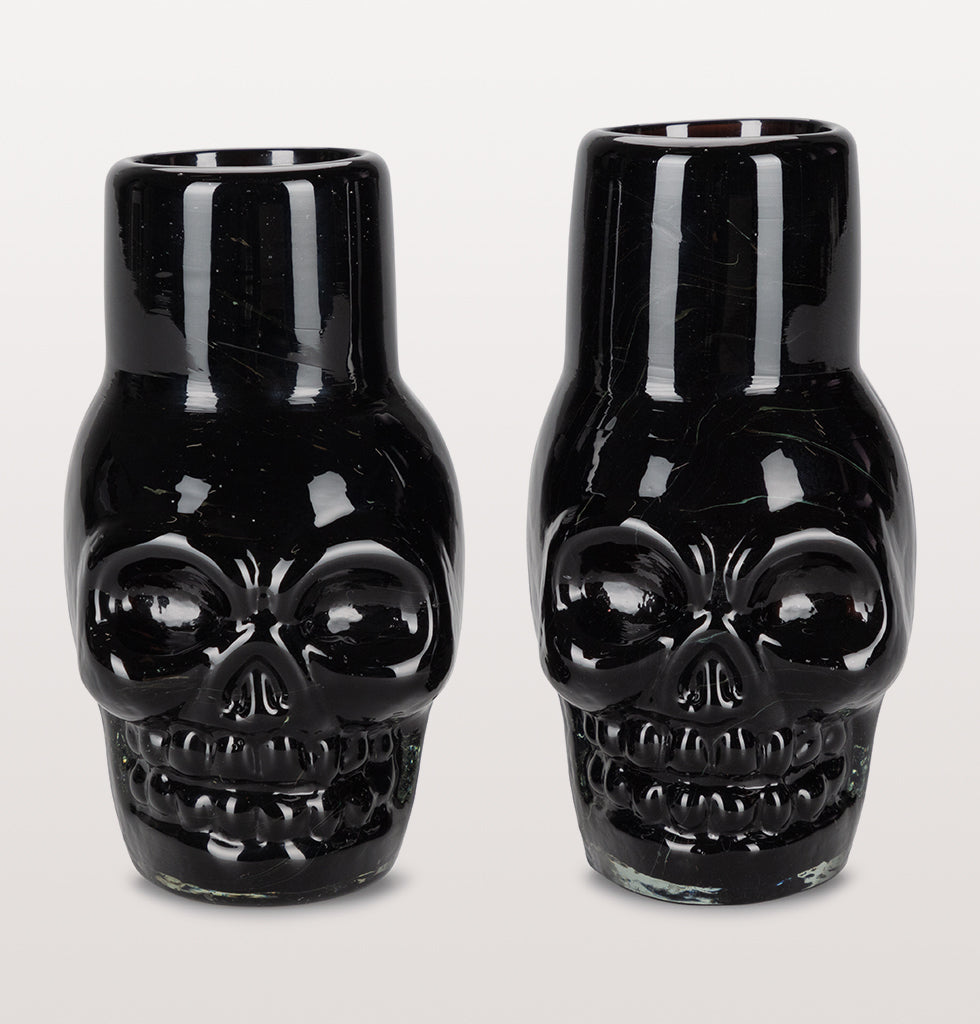 Set the tone for a good night with these fun skull shaped Mezcal shot glasses.  The black coloured glass is hand made in Mexico from recycled glass. Stunning miniature shot glasses for wild nights in and good times.