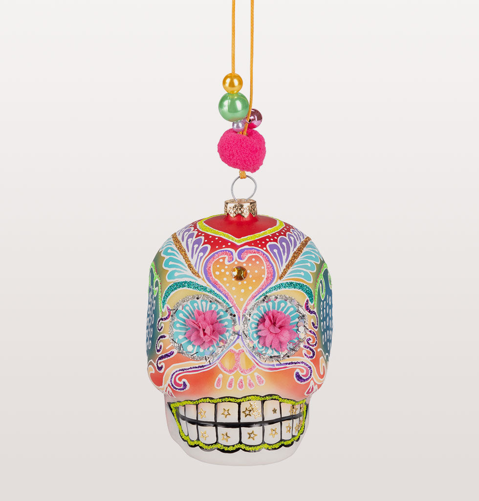 Our Dia De Los Muertos inspired pottery Christmas decoration is a celebration in itself. Beautifully intricate, with paper floral eyes, pom pom embellishments and hand painted details, you'll be taking Christmas decor to another level.