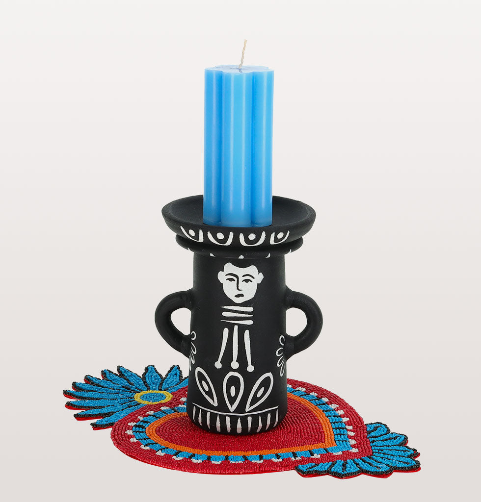 W.A.GREEN | PEDRO CANDLE SET | Kitsch Kitchen black and white Mexican candleholder and red milagro heart tablemat. Tangerine Collective blue daisy candle. £58 wagreen.co.uk