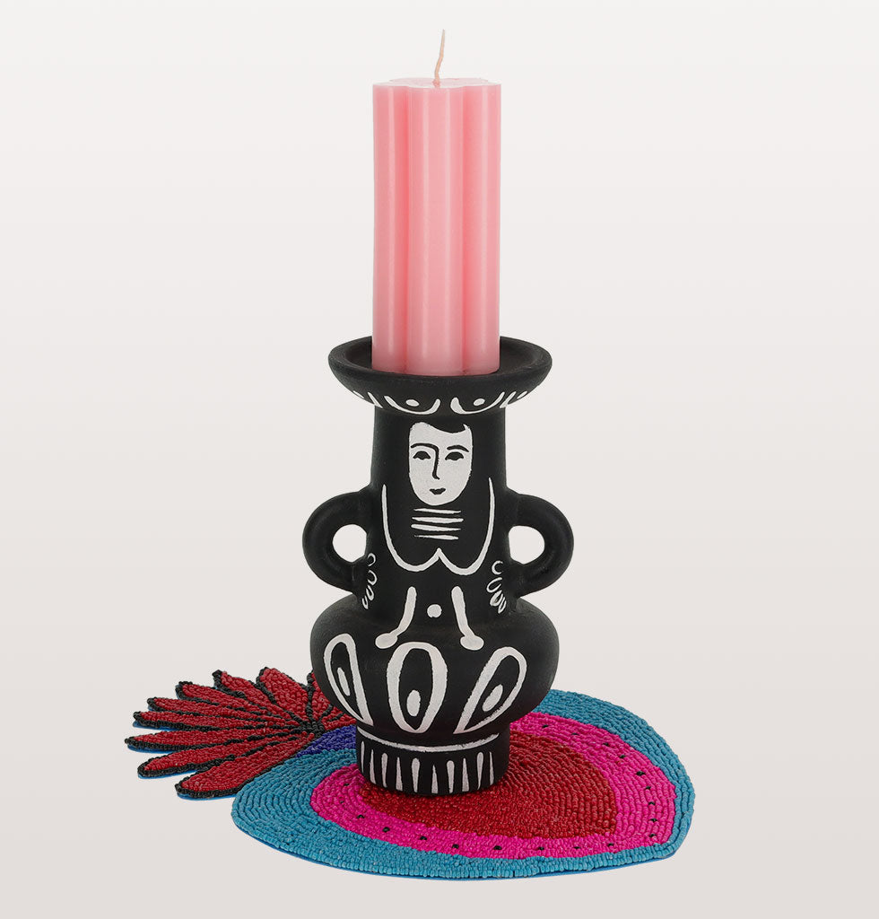 Black and white Mexican inspired Ines candleholder Kitsch Kitchen with pink daisy pillar candle and blue milagro heartmat. wagreen.co.uk