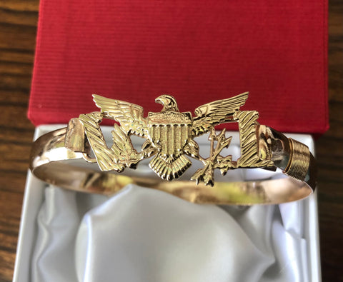 14k and 10 k gold Eagle with goldfilled wire bracelet .