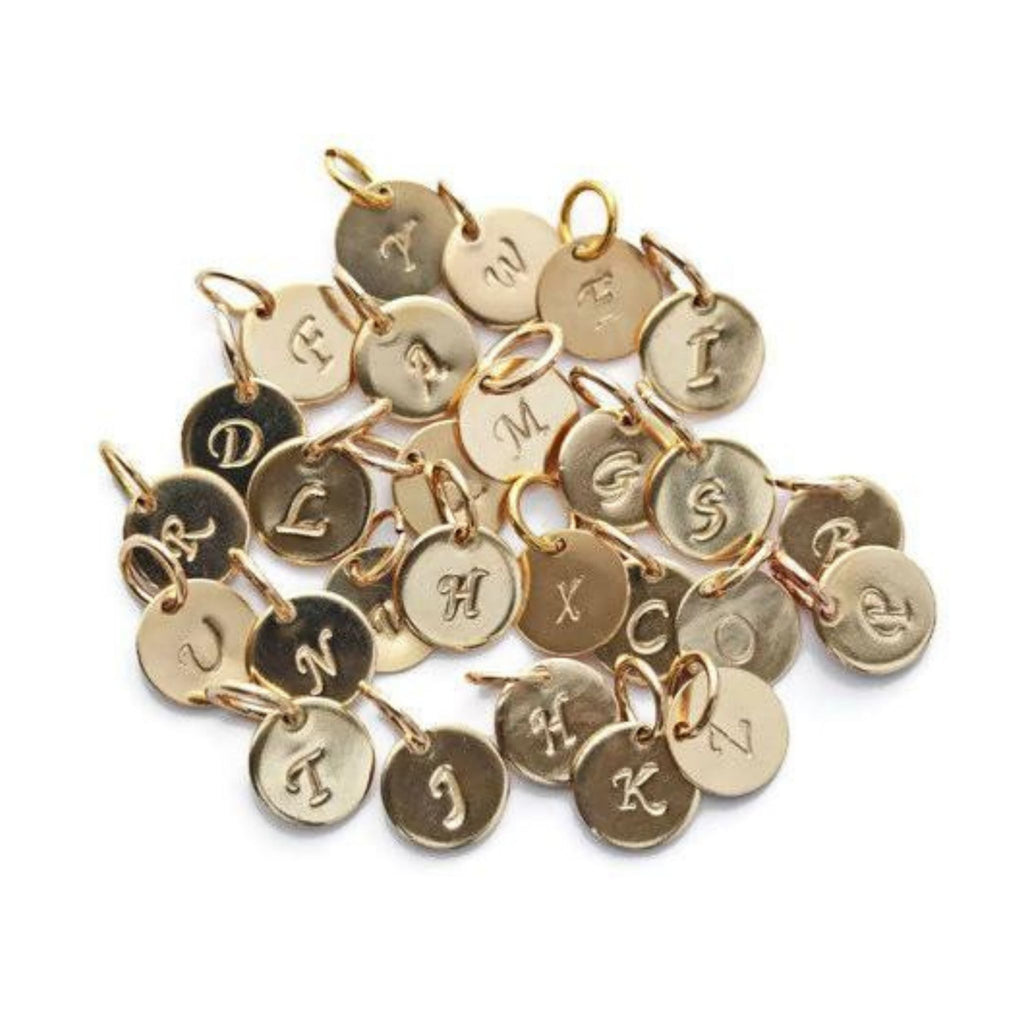Gold initial charms by Jen Lesea Designs