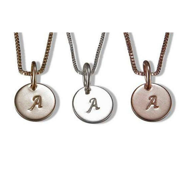 Initial charm necklaces by Jen Lesea Designs