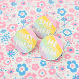 She/Her Enamel Pronoun Pin - Hand Over Your Fairy Cakes - hoyfc.com