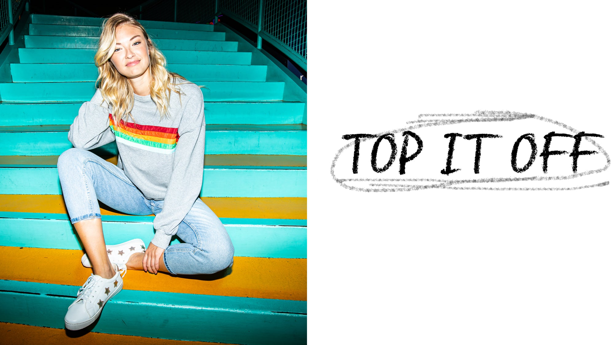 Girl wearing gray and rainbow pullover sweater and blue crop jeans