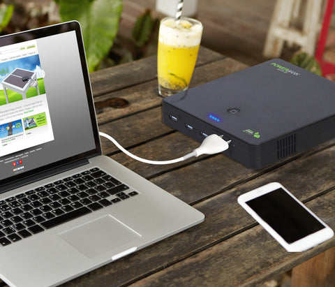 Nature Power - Power Bank Elite 25 Portable Battery Charger powering a laptop on a work desk