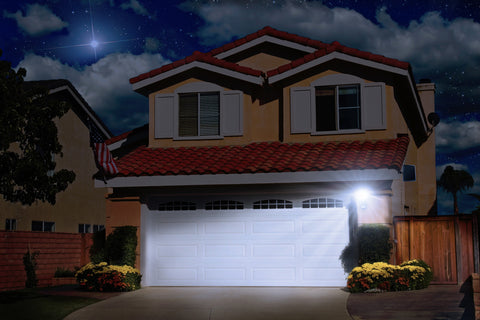 Nature Power COB Motion Activated Solar Security Light illuminating a home_s driveway