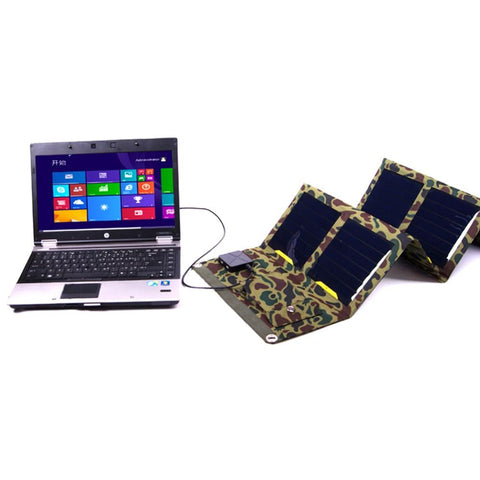 Camouflage Solar Powered Charger Charging a Computer