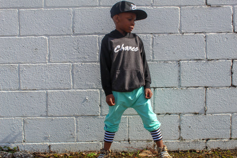 Boy in baseball hat and harem pants